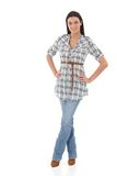 Pretty girl in jeans and shirt smiling Royalty Free Stock Photography
