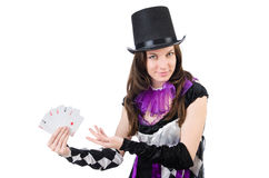 Pretty girl in jester costume with cards isolated Stock Image