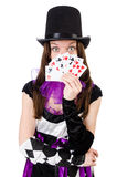 The pretty girl in jester costume with cards Royalty Free Stock Images
