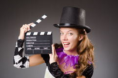 Pretty girl in jester costume holding clapperboard Royalty Free Stock Photo