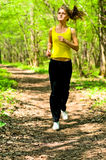 Pretty girl jogging Stock Images