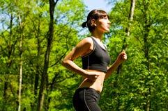 Pretty girl jogging Royalty Free Stock Photos