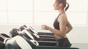 Pretty girl jogging in gym