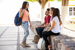 Pretty girl joining a group royalty free stock image