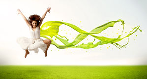 Pretty girl jumping with green abstract liquid dress Stock Photos