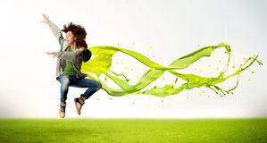 Pretty girl jumping with green abstract liquid dress Royalty Free Stock Image