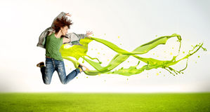 Pretty girl jumping with green abstract liquid dress Stock Photography