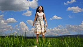 Pretty Girl Jumping In Green Field stock footage