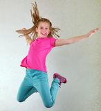 Pretty girl jumping high and dancing royalty free stock image