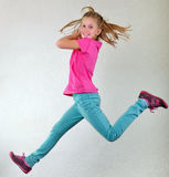 Pretty girl  jumping high, dancing and running Royalty Free Stock Photography