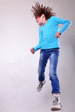 Pretty girl  jumping high, dancing and running Royalty Free Stock Images