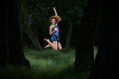 Pretty girl jumping in woods Royalty Free Stock Photos