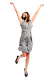 Pretty girl jumps with her arms up Stock Image