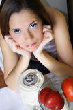 Pretty girl in the kitchen Stock Photography