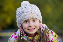 Pretty girl in knit cap. Pretty girl in knit cap smiling Royalty Free Stock Photography