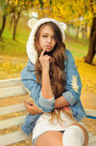 Pretty girl in a knitted bear hat. Royalty Free Stock Photos