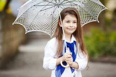 Pretty girl with lace umbrella in white suit Stock Photo
