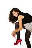Pretty girl laces red shoe Royalty Free Stock Photography