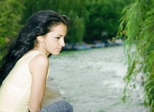 Pretty girl by the lake Stock Images