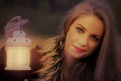 Pretty girl with a lantern Royalty Free Stock Photo