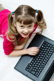 Pretty girl with laptop Royalty Free Stock Images