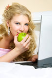Pretty girl with a laptop Royalty Free Stock Photos