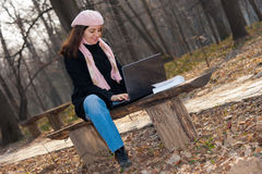 Pretty girl with laptop outdoor Royalty Free Stock Photos