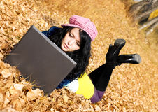 Pretty girl with a laptop outdoor Stock Photos