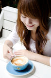 Pretty girl with latte coffee01. Thai pretty girl have a cup of latte coffee Stock Photography