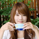 Pretty girl with latte coffee02. Thai pretty girl have a cup of latte coffee Stock Images