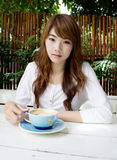 Pretty girl with latte coffee03. Thai pretty girl have a cup of latte coffee Stock Image