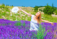 Pretty girl on lavender field Stock Image