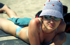 Pretty Girl Laying on the Beach Royalty Free Stock Image