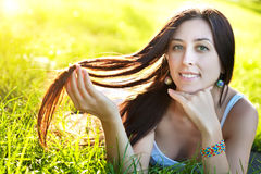 Pretty girl laying on the grass Royalty Free Stock Images