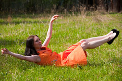 Pretty girl laying on grass Stock Images