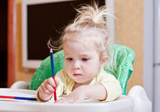 Pretty girl learning to draw with. Pencils stock photos