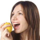 Pretty girl with lemon Royalty Free Stock Images