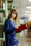 Pretty girl in library. Asian pretty girl reading the book in library Stock Photo