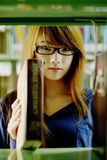 Pretty girl in library. Asian pretty girl choose the book in library Royalty Free Stock Images
