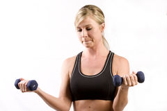 Pretty girl lifting two weights Stock Photography