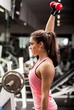 Pretty girl lifting weights Royalty Free Stock Photo