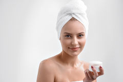 Pretty girl likes skincare treatment Royalty Free Stock Images