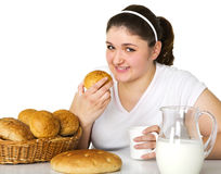 Pretty girl likes to eat Stock Images