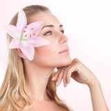 Pretty girl with lily flower Royalty Free Stock Photography