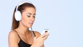 Pretty girl is listen to the music stock footage