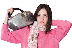 Pretty girl listening music and holding portable CD radio. On white background Stock Photos