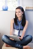 Pretty girl listening music on tablet PC Stock Photos
