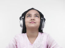 Pretty girl listening to music Royalty Free Stock Image