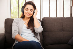 Pretty girl listening to music Stock Image