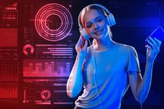 Pretty girl listening to music and dancing while relaxing stock image